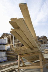 Stack of wooden beams at construction site