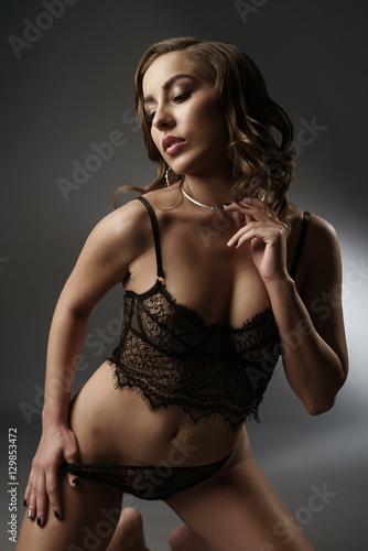 ec420cfdcc8 Woman in lingerie posing on dark background