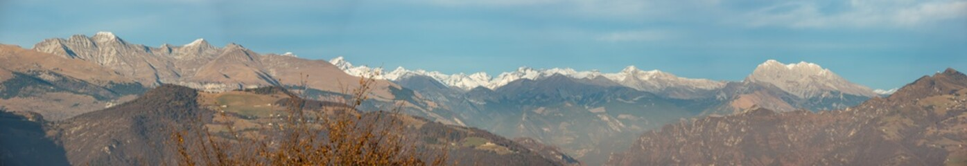 Great landscape on the Orobie Alps in fall season. View of the highest mountains including Presolana. Panorama from Rena pick, Seriana Valley, Bergamo, Italy.