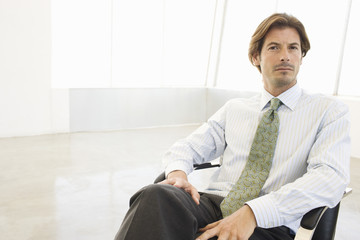 Portrait of a mature businessman sitting in office