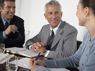 Three business colleagues discussing at conference table