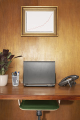 Interior of an office laptop and other items on desk