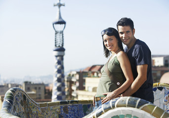 Portrait of happy young couple standing together at Barcelona