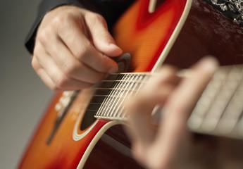 Closeup shot of hands playing the guitar