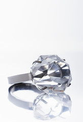 Closeup of diamond ring isolated over white background