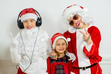two boys pretending he is a Bad Santa