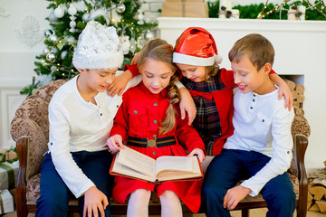 Kids reading a story book on Christmas time