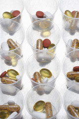 Pills and tablets in plastic cups