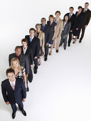 Full length group portrait of multiethnic businesspeople in a row against white background