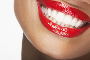 Detailed image of beautiful woman smiling with red lips on white background