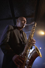 Low angle view of a musician playing saxophone in the jazz club