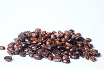 Whole coffee beans on white background, fresh and aroma concept.