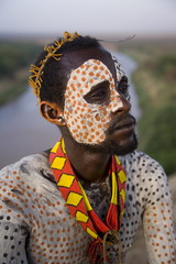Portrait of a Karo tribesman with facial decoration in chalk imitating the spotted plumage of the guinea fowl, Lower Omo Valley, Ethiopia, Africa