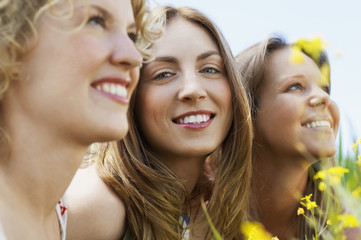 Closeup portrait of teenage girl smiling while friends looking away