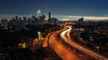 Wall Murals Kuala Lumpur Light trail scenery at the busy highway in Kuala Lumpur city at night