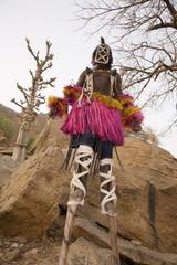 Masked ceremonial Dogon dancer on stilts near Sangha, Bandiagara escarpment, Dogon area, Mali, West Africa, Africa