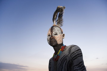 Portrait of a Karo tribesman with facial decoration imitating the spotted plumage of the guinea fowl, Omo River, Lower Omo Valley, Ethiopia, Africa