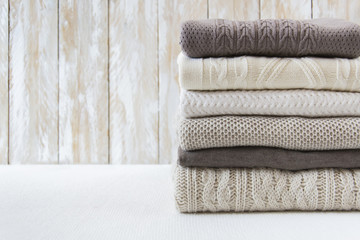 Stack of warm knitted sweaters
