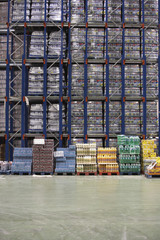 Rows of shelves with drinks in warehouse