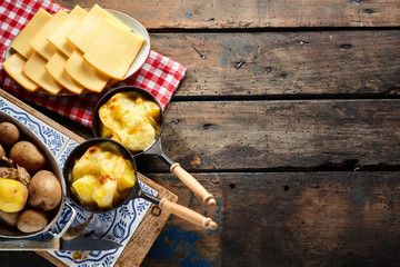 Delicious traditional Swiss melted raclette cheese Wall mural