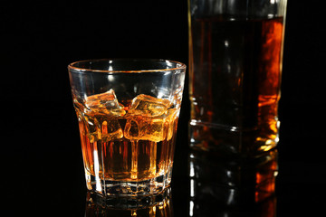 Glass of whisky on dark background