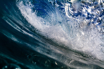 Inside blue ocean wave. Sea water in barrel shape wave closing