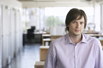 Closeup portrait of a young businessman against blurred background