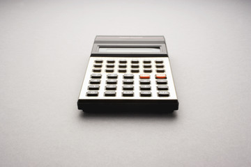 Old fashioned calculator on white background studio shot