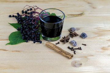 Bunch of fresh elderberries with juice and spices