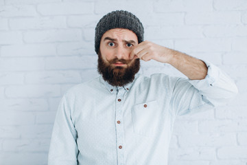 Stylish bearded and mustache man in a cap and shirt