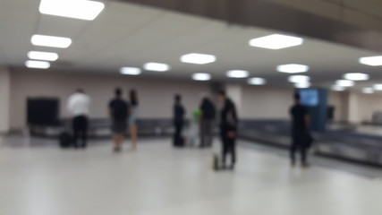 Blurry abstract Travelers waiting for their luggage at the bagga