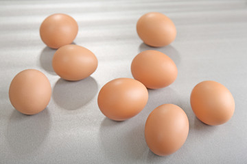 Raw eggs on grey background