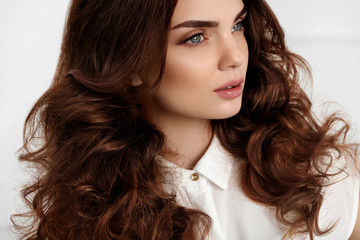 Beautiful Girl Model With Wavy Curly Hairstyle. Brown Hair Color
