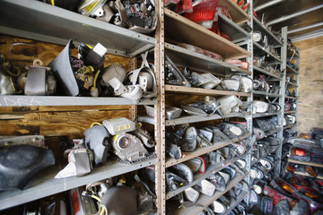 Interior of storeroom with old car parts in rack