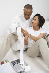 An African American couple doing bills