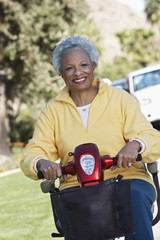 Portrait of an African American senior woman on motor scooter