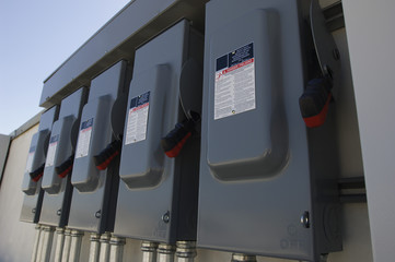 Closeup of electrical breaker boxes at solar power plant
