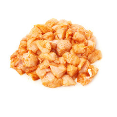 Raw chicken fillet cutted into pieces and spiced isolated over white background