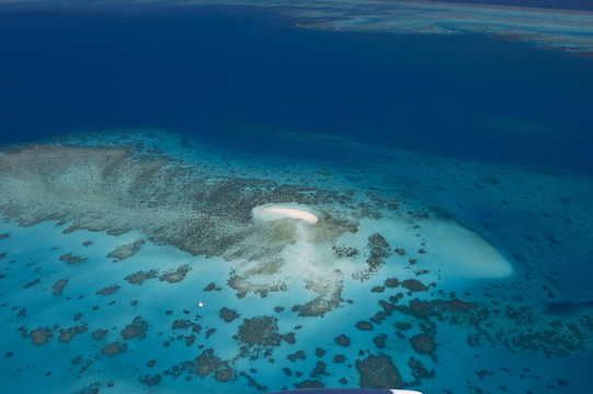 Aerial photography of coral reef formations of the Great Barrier Reef, near Cairns, North Queensland
