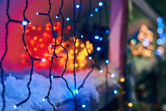 LED electric Christmas lights making beautiful magical colors and bokeh