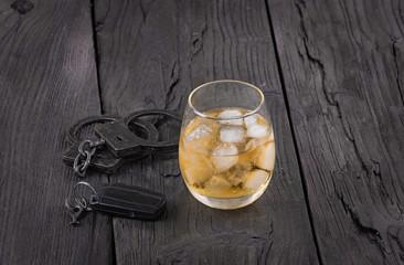 whiskey, handcuffs, car key