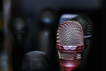 Silver microphone in a dark blurry  background