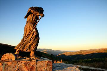 Bronze statue of a pilgrim Wall mural