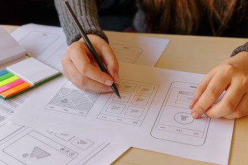 Designer wireframing a mobile App