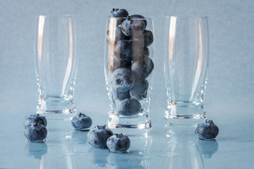 Blueberries in dessert and beverage glasses