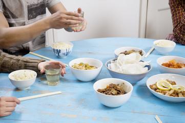 People having breakfast on table together