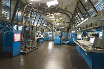 Interior view of a spacious newspaper factory