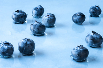 Giant blueberries scattered