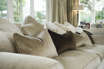 Closeup of cushions on sofa in the living room at home