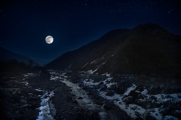full moon over mountain and river snowy landscape in Azerbaijan winter night
